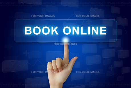 hand press on book online button on touch screenの素材 [FYI00752986]