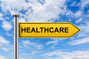 yellow road sign with healthcare wordsの素材 [FYI00752987]