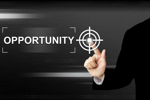 business hand pushing opportunity button on touch screenの写真素材 [FYI00754521]