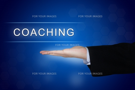 coaching button on blue backgroundの写真素材 [FYI00754527]