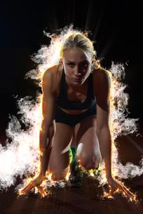 BURN FIRE  design of woman  sprinter leaving starting blocksの写真素材 [FYI00754562]