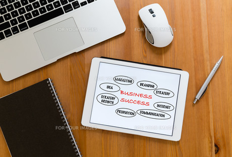 Office table with digital tablet showing marketing success conceptの写真素材 [FYI00754889]