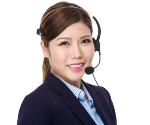 Young businesswoman with headsetの写真素材 [FYI00755399]