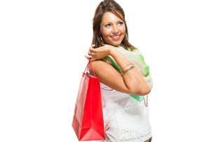 young attractive woman with dark hair and red shopping bag saleの写真素材 [FYI00755937]