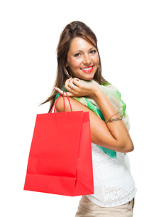 young attractive woman with dark hair and red shopping bag saleの写真素材 [FYI00755945]