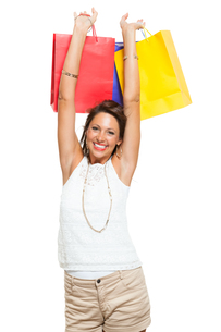 young stylish woman with colorful shopping bags sale saleの写真素材 [FYI00755951]