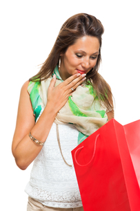 young attractive woman with dark hair and red shopping bag saleの写真素材 [FYI00755953]