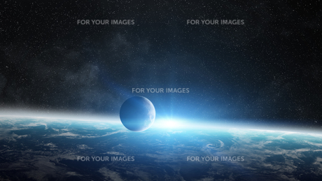 Sunrise over planet Earth in spaceの写真素材 [FYI00756466]