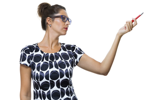 attractive businesswoman pointing with a pen to topの写真素材 [FYI00756527]