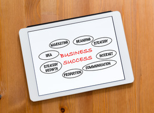 Digital Tablet on a desk and showing marketing success conceptの写真素材 [FYI00757524]