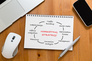 Office table with handbook drafting about marketing Strategy conceptの写真素材 [FYI00757535]