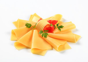 Sliced cheese, butter and tomato wedgesの写真素材 [FYI00757784]