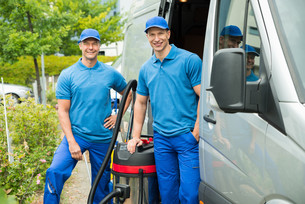 Two Male Cleaners With Vacuum Cleanerの写真素材 [FYI00758796]