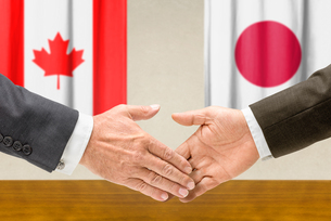 representatives canada and japan join handsの写真素材 [FYI00758880]