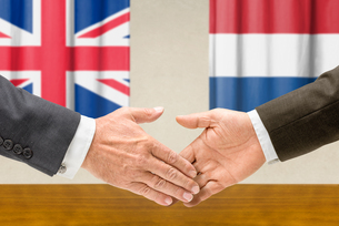 representatives of britain and the netherlands join handsの写真素材 [FYI00758881]