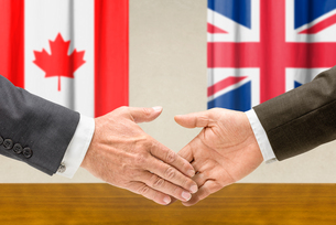representatives of canada and the united kingdom join handsの写真素材 [FYI00758888]