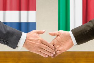 representatives of the netherlands and italy join handsの写真素材 [FYI00758904]