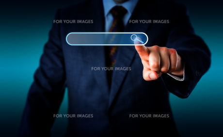 Businessman Touching Magnifier Icon In Search Boxの写真素材 [FYI00758937]