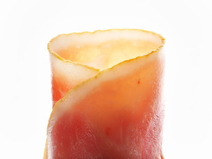 Thin slices of cooked ham, rolled upの写真素材 [FYI00759082]
