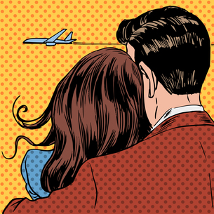 Loving couple looking at a plane taking off in the skyの写真素材 [FYI00759882]