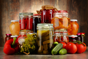 Jars with pickled vegetables and fruity compotesの写真素材 [FYI00759950]