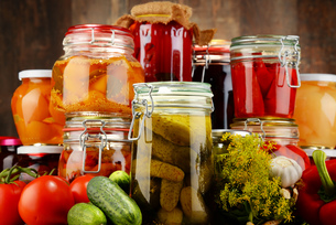 Jars with pickled vegetables and fruity compotesの写真素材 [FYI00759951]
