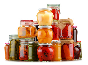 Jars with pickled vegetables and fruity compotes on whiteの写真素材 [FYI00759952]