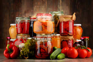 Jars with pickled vegetables and fruity compotesの写真素材 [FYI00759953]