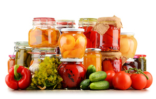 Jars with pickled vegetables and fruity compotes on whiteの写真素材 [FYI00759955]