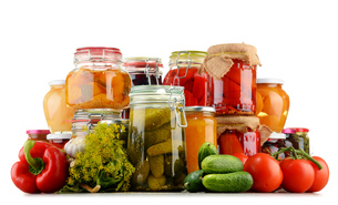 Jars with pickled vegetables and fruity compotes on whiteの写真素材 [FYI00759956]