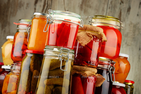 Jars with pickled vegetables and fruity compotesの写真素材 [FYI00759960]