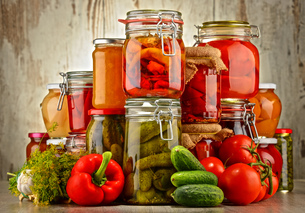 Jars with pickled vegetables and fruity compotesの写真素材 [FYI00759961]