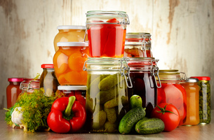 Jars with pickled vegetables and fruity compotesの写真素材 [FYI00759969]