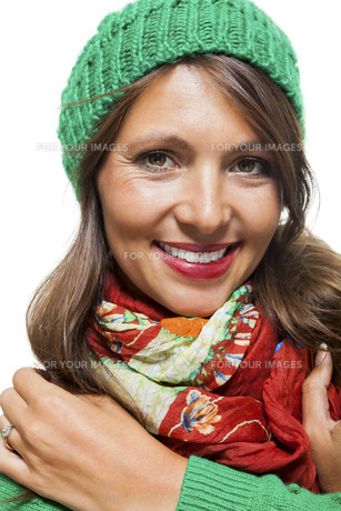 attractive young woman with long dark hair with green capの写真素材 [FYI00760074]