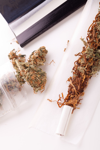 cannabis marijuana with paper and joint for rotating drugの写真素材 [FYI00760376]