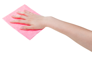 hand with pink cleaning rag isolated on whiteの写真素材 [FYI00761581]