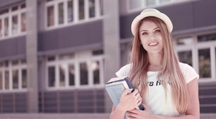 Pretty Student with Books Against the Universityの写真素材 [FYI00761604]