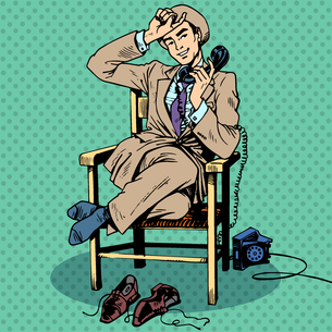 Tired man sits chair talking phoneの写真素材 [FYI00761648]