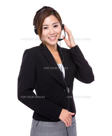 Female businesswoman with headsetの写真素材 [FYI00761915]