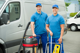 Two Cleaners Standing With Cleaning Equipmentsの写真素材 [FYI00763255]