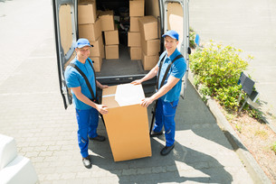 Two Movers Loading Boxes In Truckの写真素材 [FYI00763265]