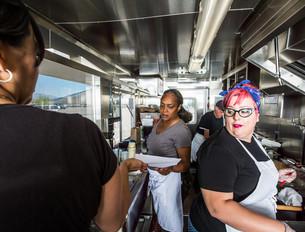 Preparing Food on Busy Food Truckの写真素材 [FYI00764265]