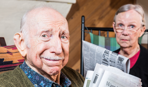 Elderly Man and Woman with Newspaperの写真素材 [FYI00764277]