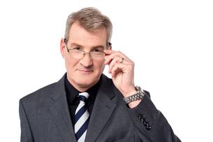 Senior man skeptical with eyeglassesの写真素材 [FYI00764624]