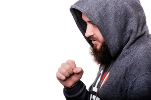 Full Face Boxer with a serious face with a beard in the hood inの写真素材 [FYI00765355]