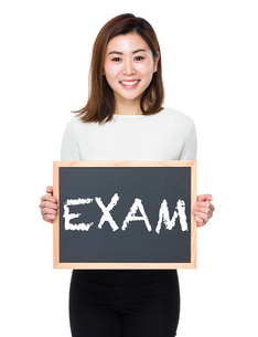 Young woman with the blackboard showing a word examの写真素材 [FYI00765893]