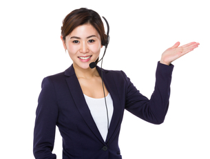 Call center agent with open hand palm for selling somethingの写真素材 [FYI00766020]