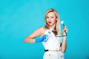 funny sexy girl doctor nurse with syringe stethoscopeの写真素材 [FYI00767339]