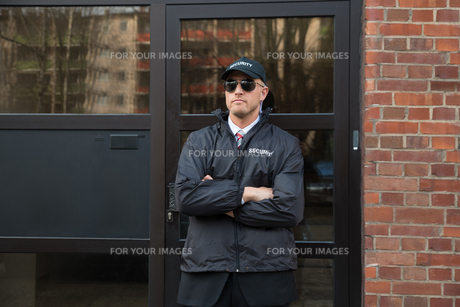 Security Guard Standing In Front Of The Entranceの写真素材 [FYI00767562]