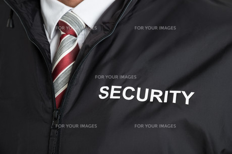 Security Guard Wearing Uniform With The Text Securityの写真素材 [FYI00767566]